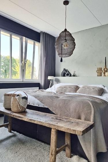 betonlook muur slaapkamer